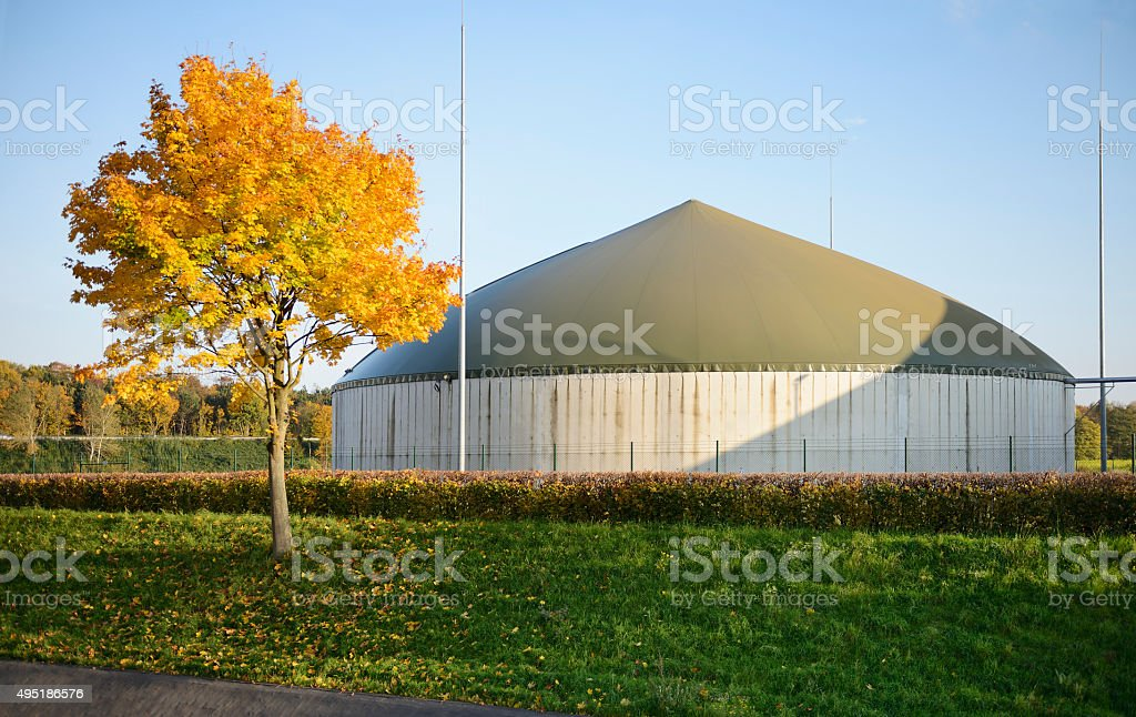 Biogas plant and autumnal tree stock photo