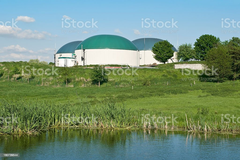 Biogas plant for agriculture, in front a biotope royalty-free stock photo