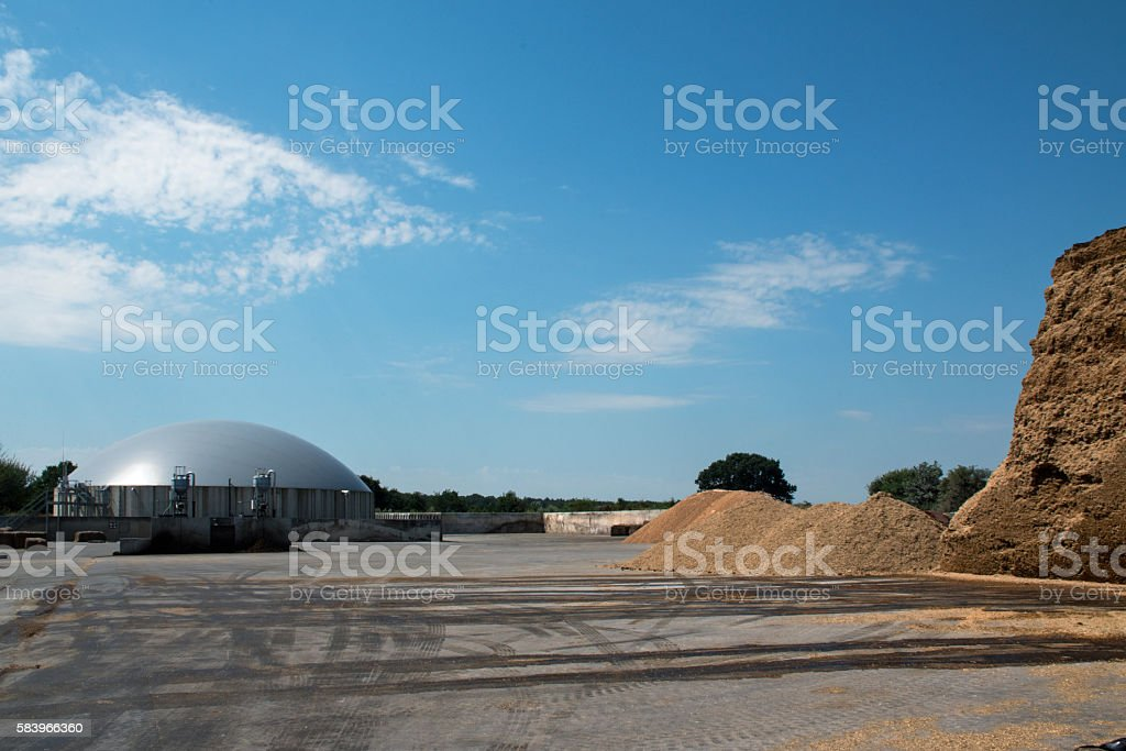 biogas plant for renewable energy and biomass, blue sky stock photo