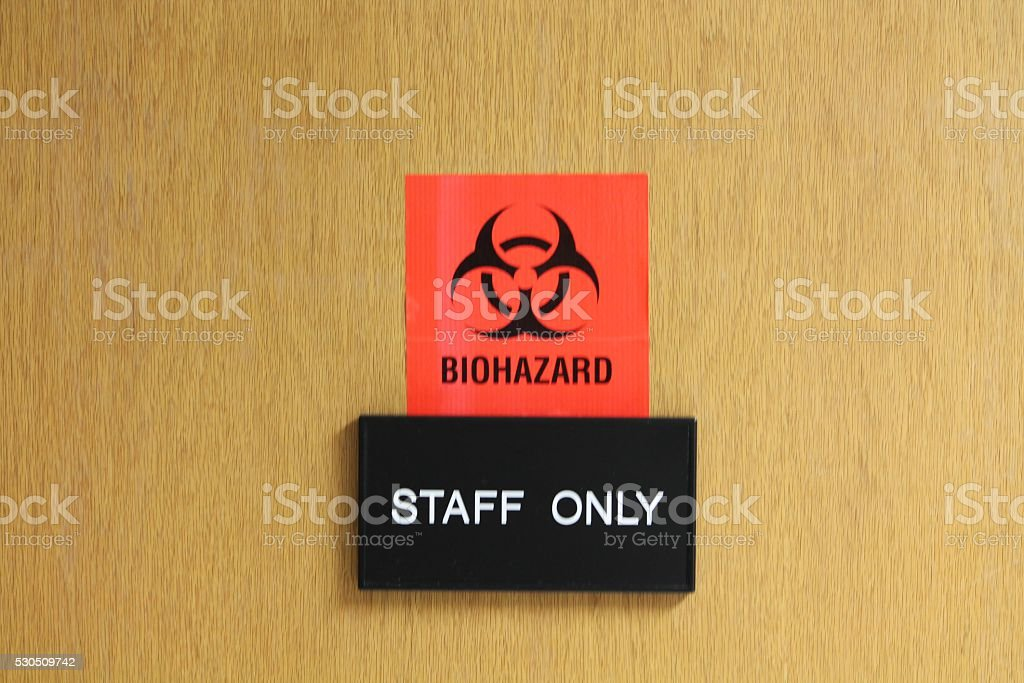 Biohazard Sign on Door stock photo