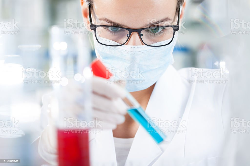 Biologist analyzing result of testing stock photo