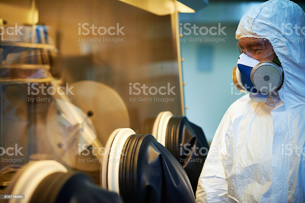 Biologist near glove box stock photo