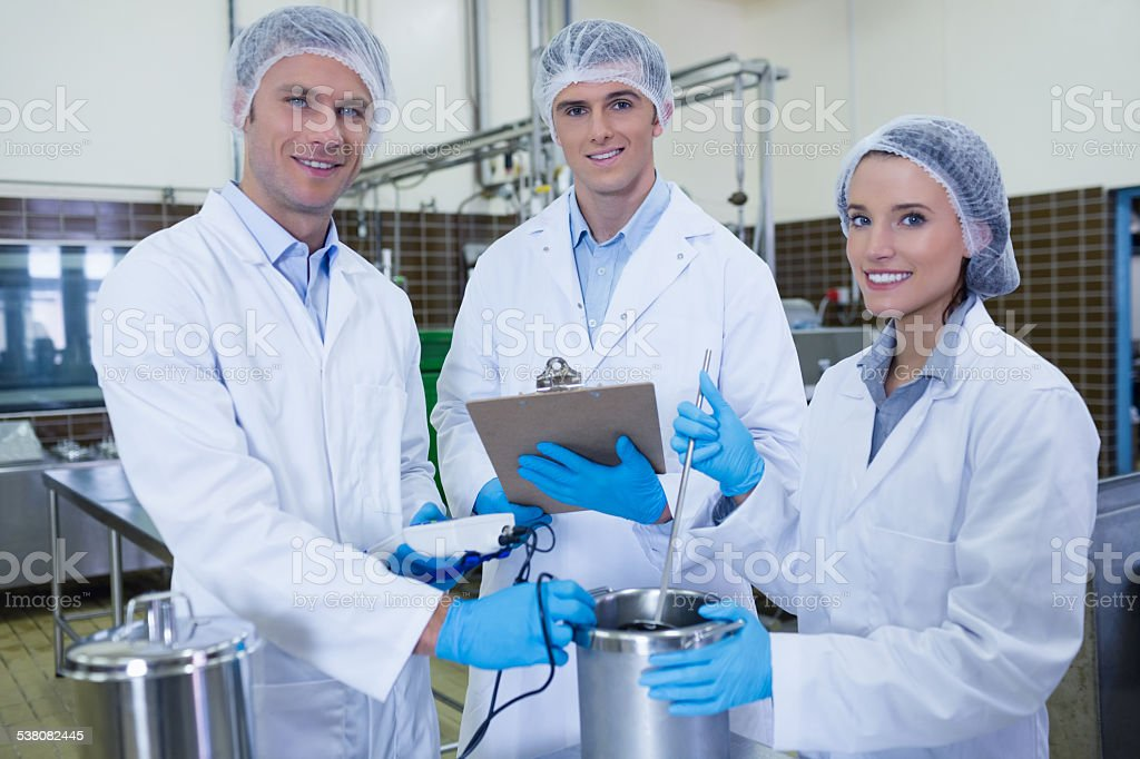 Biologist team smiling at camera stock photo