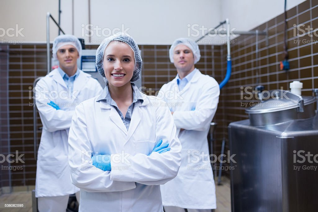 Biologist team standing smiling with arms crossed stock photo