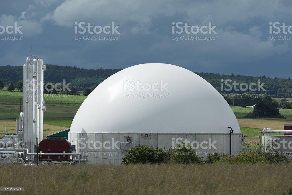 Biomass energy plant under an approaching thunderstorm, Bioenergie stock photo