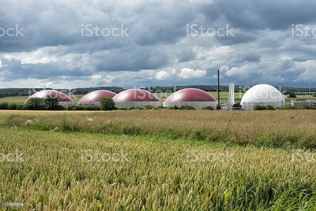 Biomass energy plant under an approaching thunderstorm stock photo