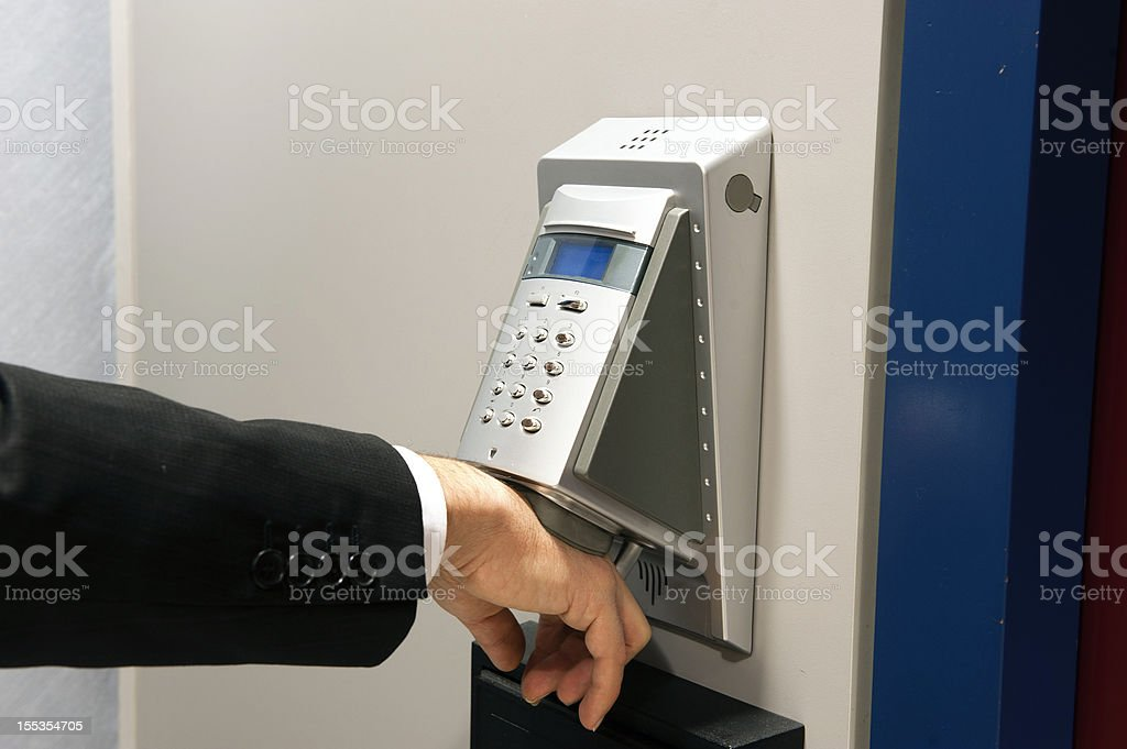 Biometric hand scanning for security stock photo