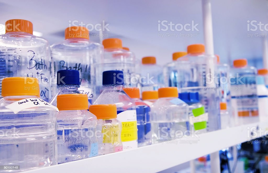 Biotechnology solutions stored on an open shelf in a lab royalty-free stock photo