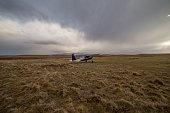 Biplane on meadow, New Zealand
