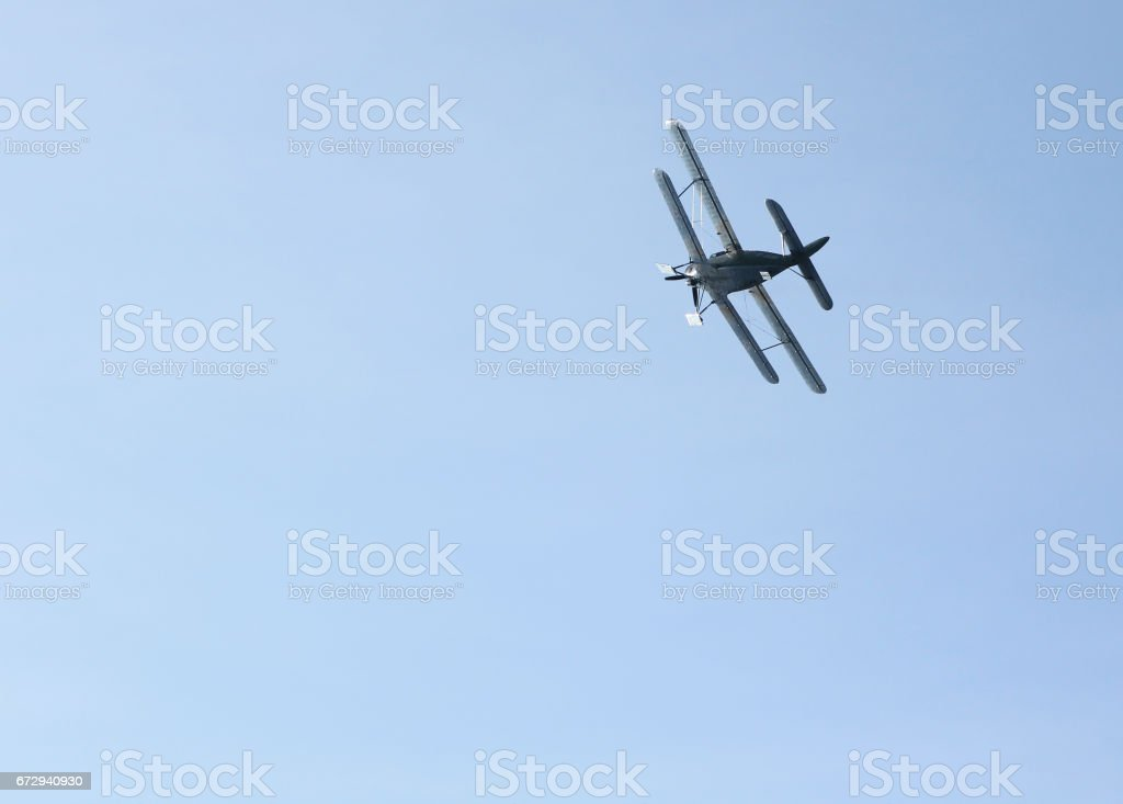 Biplane with skis instead of wheels against the sky. stock photo