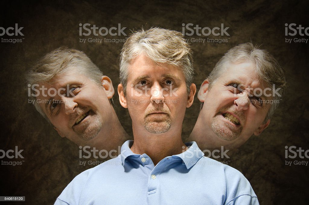 Bipolar mentally ill split personality depiction stock photo