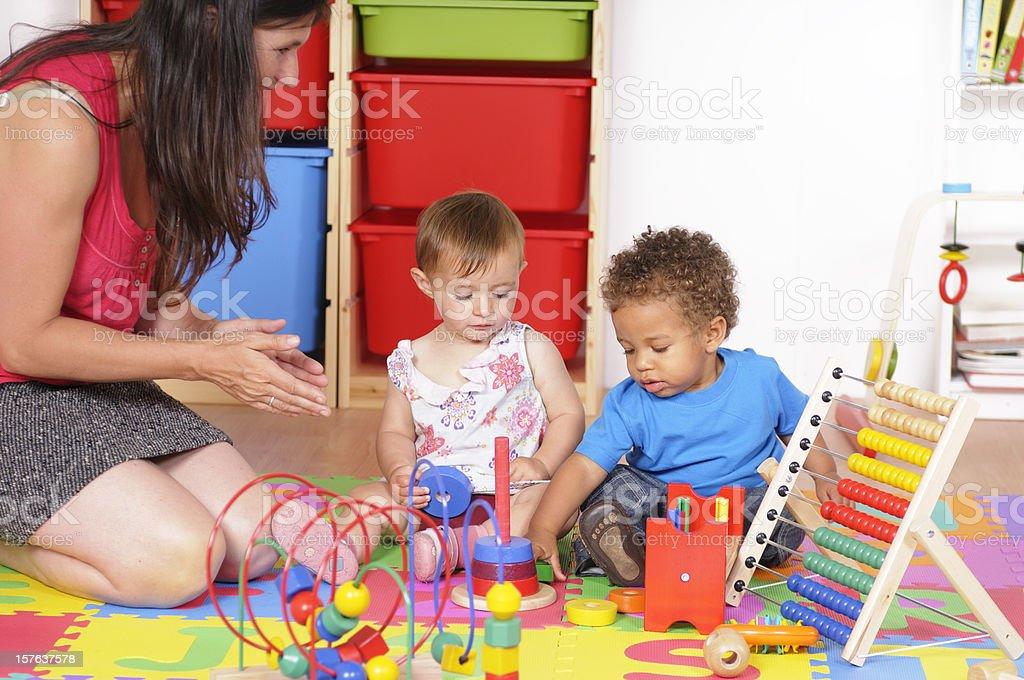 Biracial Baby Boy And His Peer Enjoying Playtime stock photo