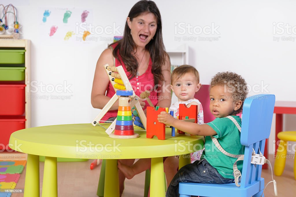 Biracial Baby Boy Holding A Developmental Toy During Playtime stock photo