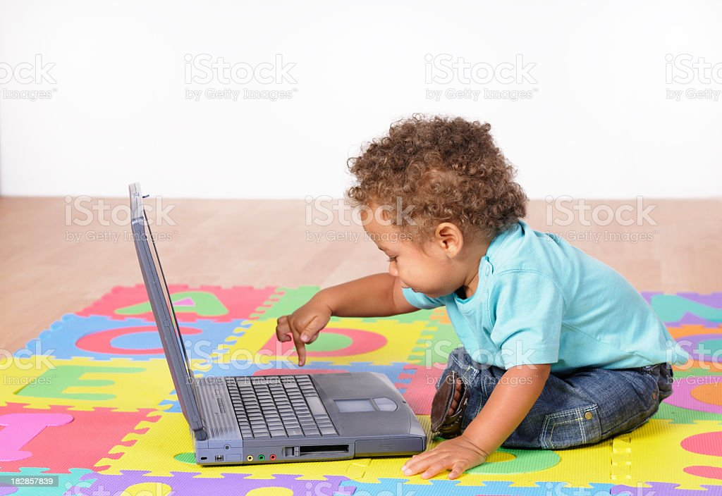 Biracial Baby Boy/ Toddler Using A Laptop stock photo