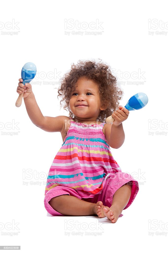 Biracial Baby Girl/ Toddler Waving Her Maracus Isoltated On White stock photo