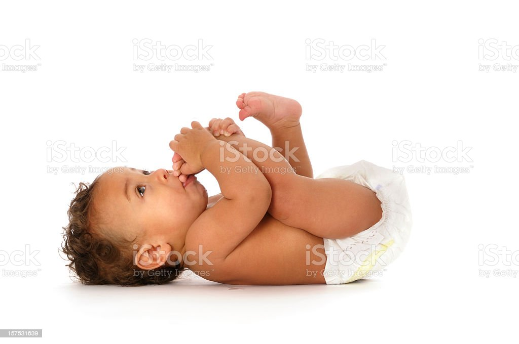 Biracial Baby Sucking his Toes Isolated on white stock photo