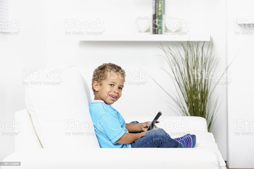 Biracial Little Boy Watching Television stock photo