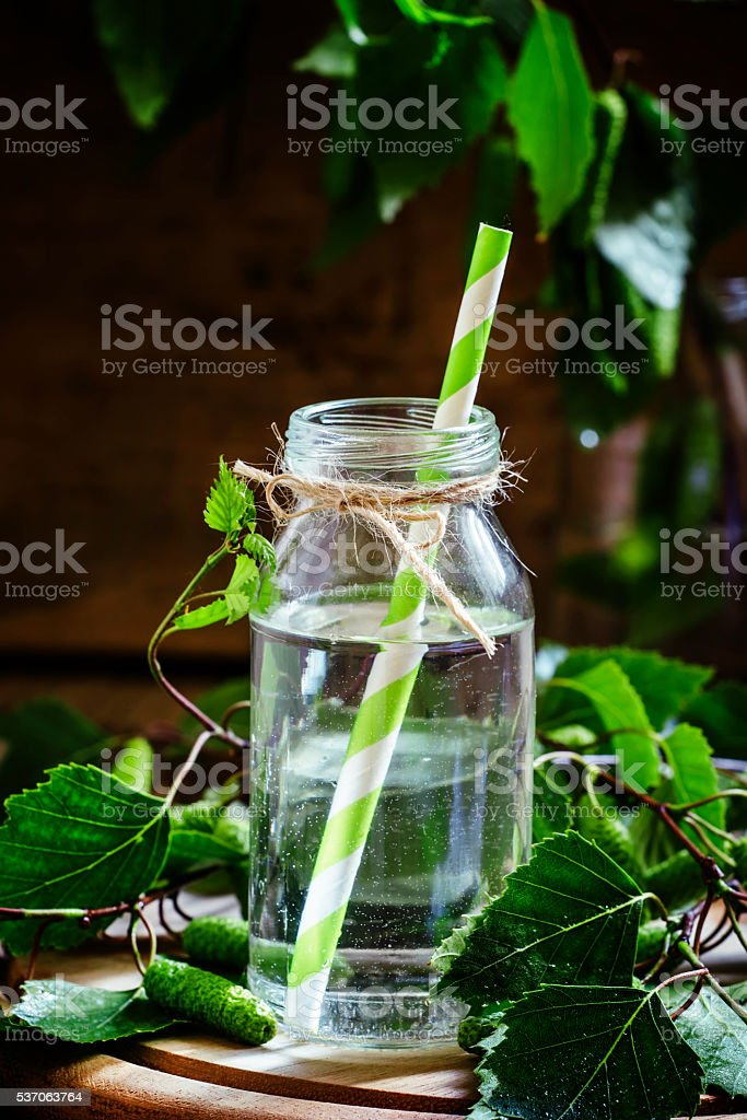 Birch sap, wood background, rustic style stock photo