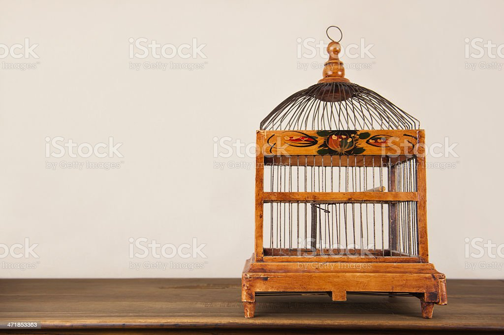 bird cage on wooden shelf royalty-free stock photo