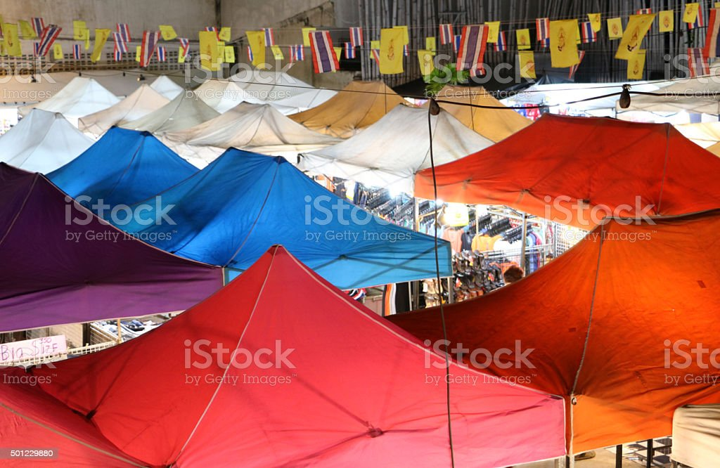 Bird eyes view of multi-colored tents in night market stock photo