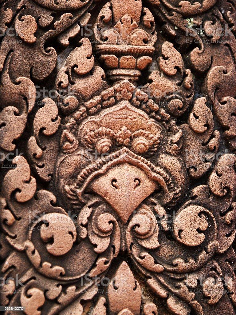 Bird face carving in sandstone, Cambodia stock photo