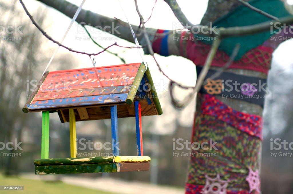 Bird feeder hanging on a tree stock photo