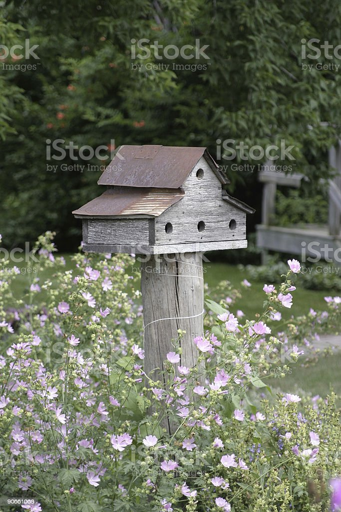 Bird House in Flowers royalty-free stock photo