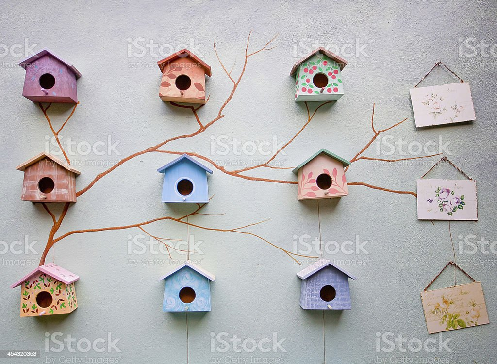 Bird house on wall royalty-free stock photo