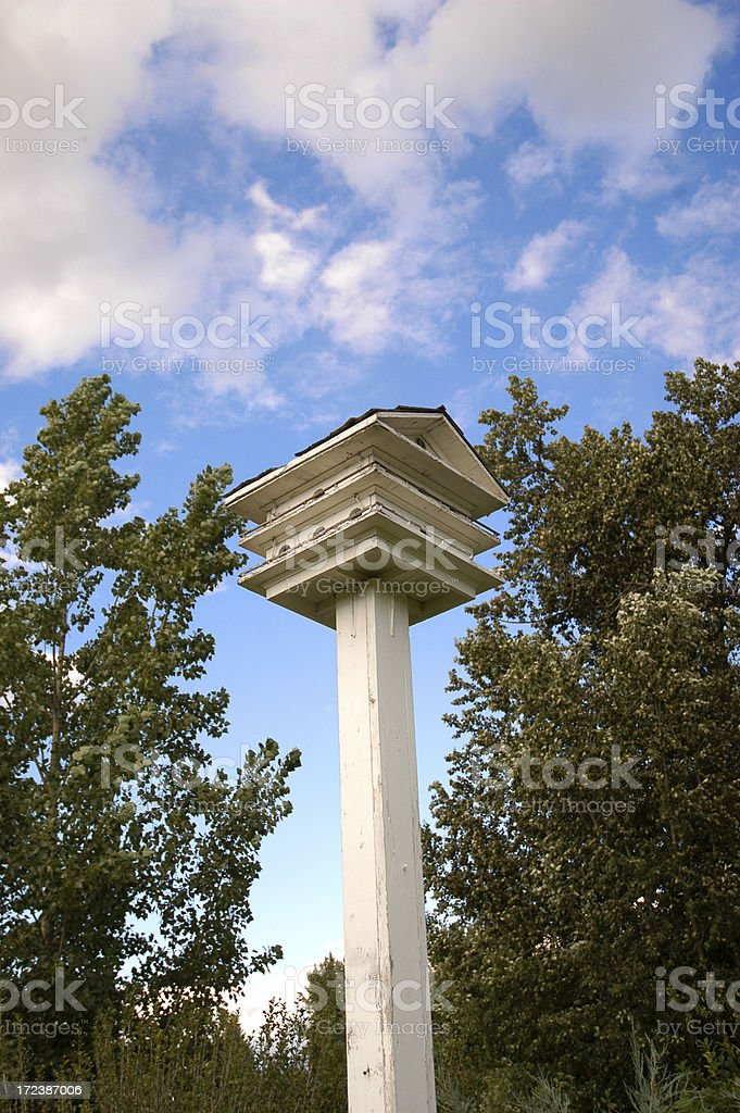 Bird house with blue sky royalty-free stock photo
