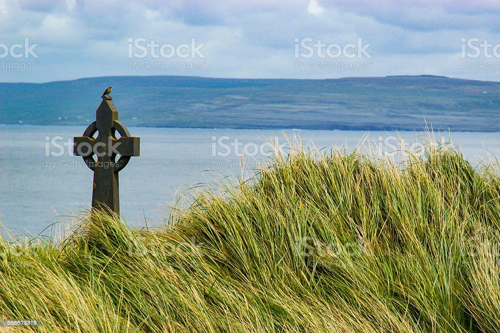 Bird on Celtic Cross stock photo