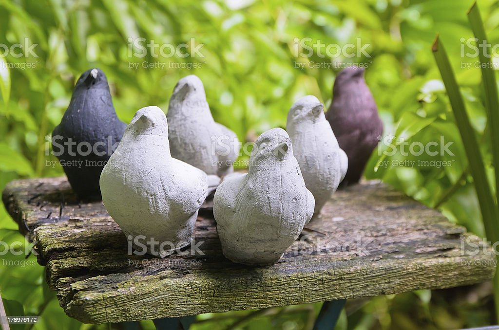 bird statues on the wooden table stock photo