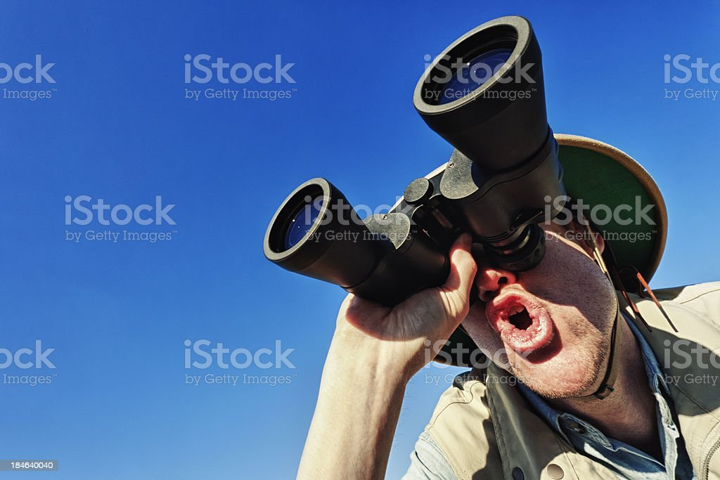 Bird Watcher Against Clear Blue Sky royalty-free stock photo