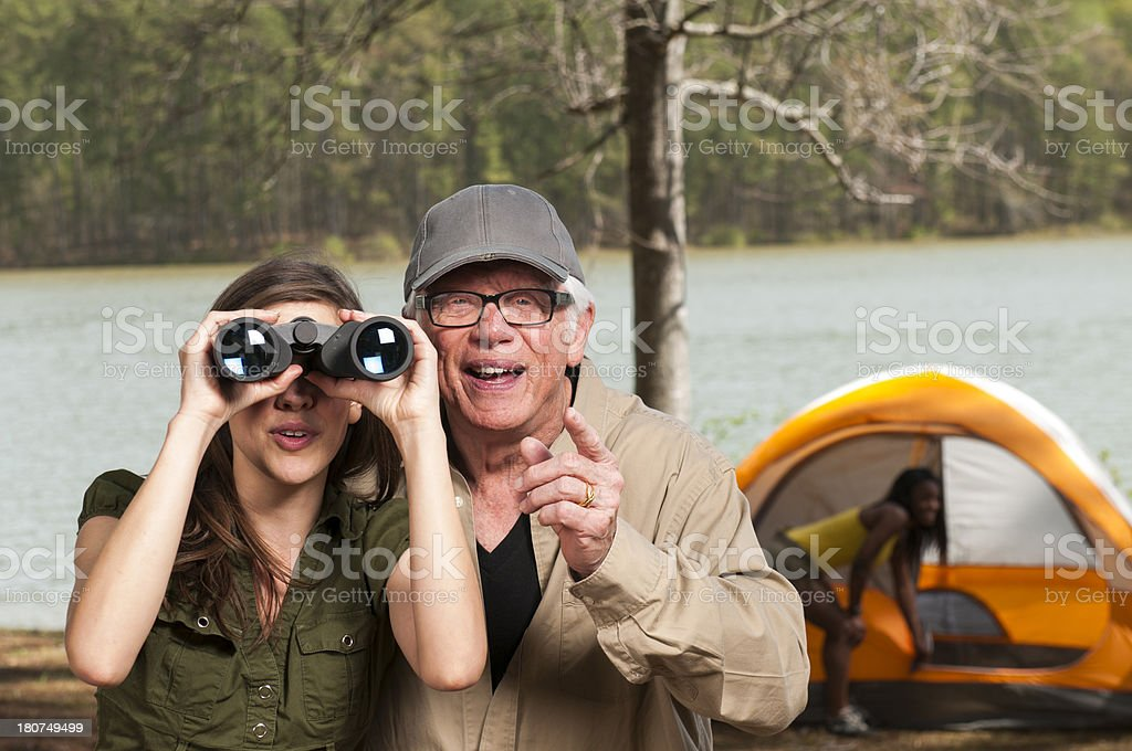 Bird Watching Grandfather and Granddaughter stock photo