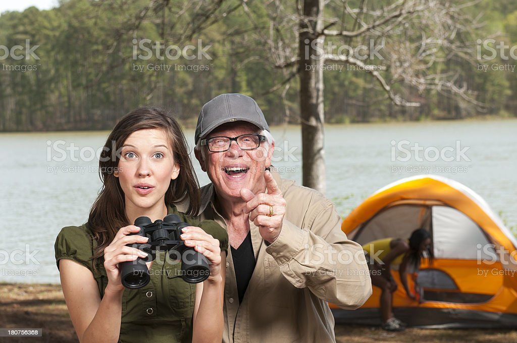 Bird Watching Grandfather and Granddaughter royalty-free stock photo