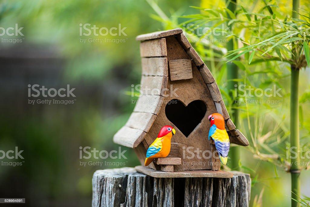 Birdhouse have a heart-shaped entrance stock photo