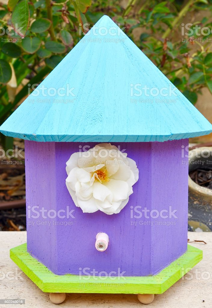 Birdhouse with Flower stock photo