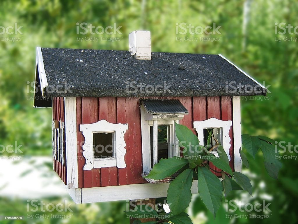 Birdhouse with green background royalty-free stock photo