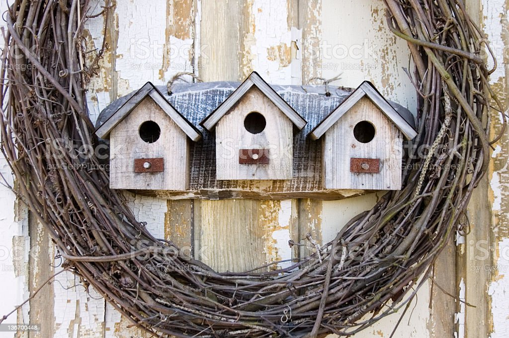 Birdhouses In A Row, Rustic Weathered and Worn royalty-free stock photo