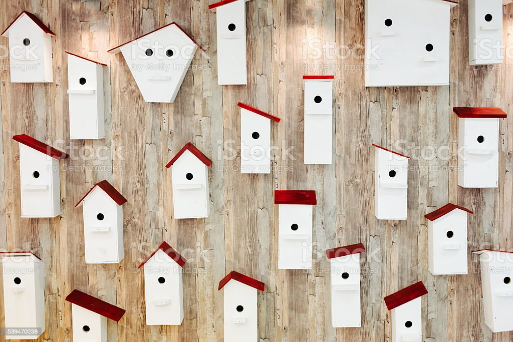 Birdhouses on the wall. Neighborhood and property concept stock photo