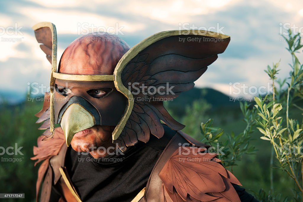 Birdman Creature Looks Out from Bush royalty-free stock photo