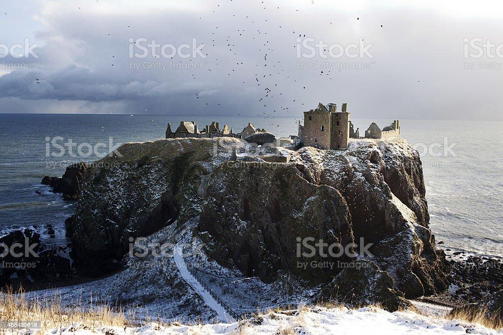 Birds and Headlands in Snow - Dunnottar Castle, Stonehaven, Scotland stock photo