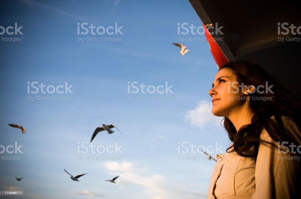 Birds and young female royalty-free stock photo