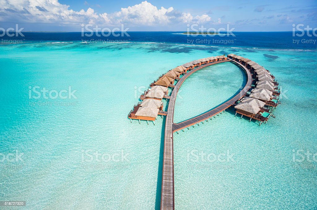 bird's eye view luxury overwater villas stock photo