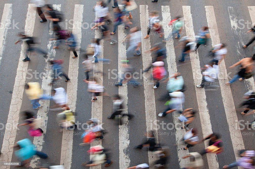 Birds eye view of blurred busy crosswalk stock photo