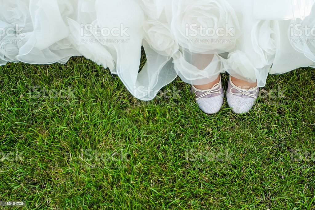 Birds eye view of brides shoes stock photo