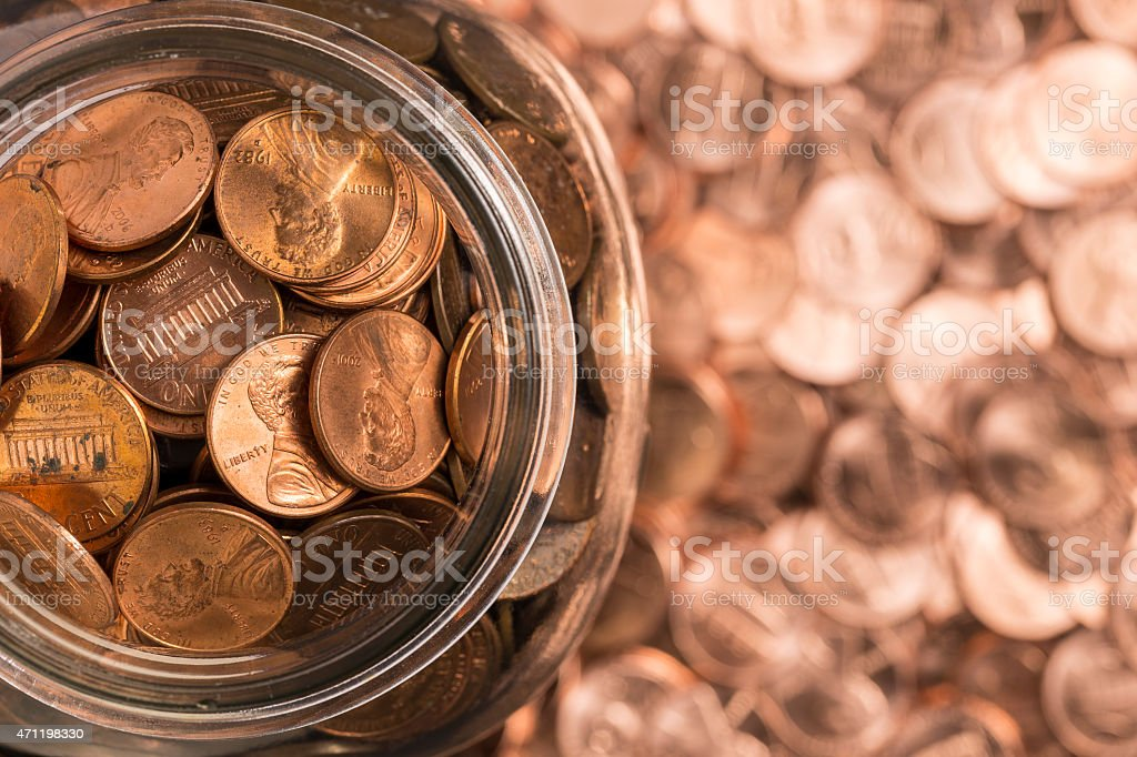 Birds eye view of penny jar overflowing stock photo