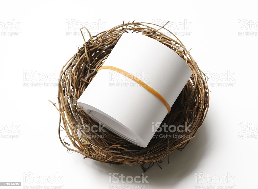 Bird's nest with blank paper roll on on white background royalty-free stock photo