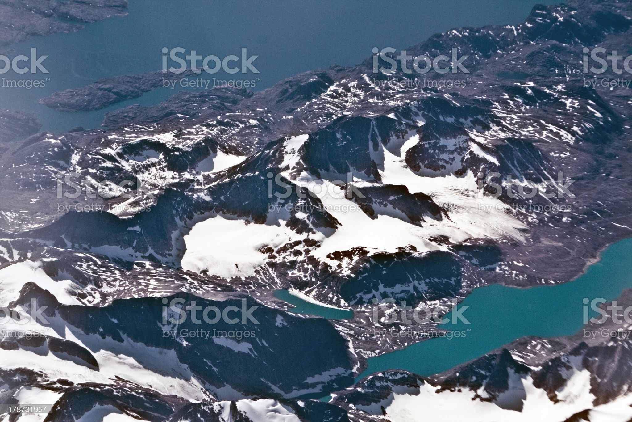 birds view from the plane toglaciers and mountains royalty-free stock photo