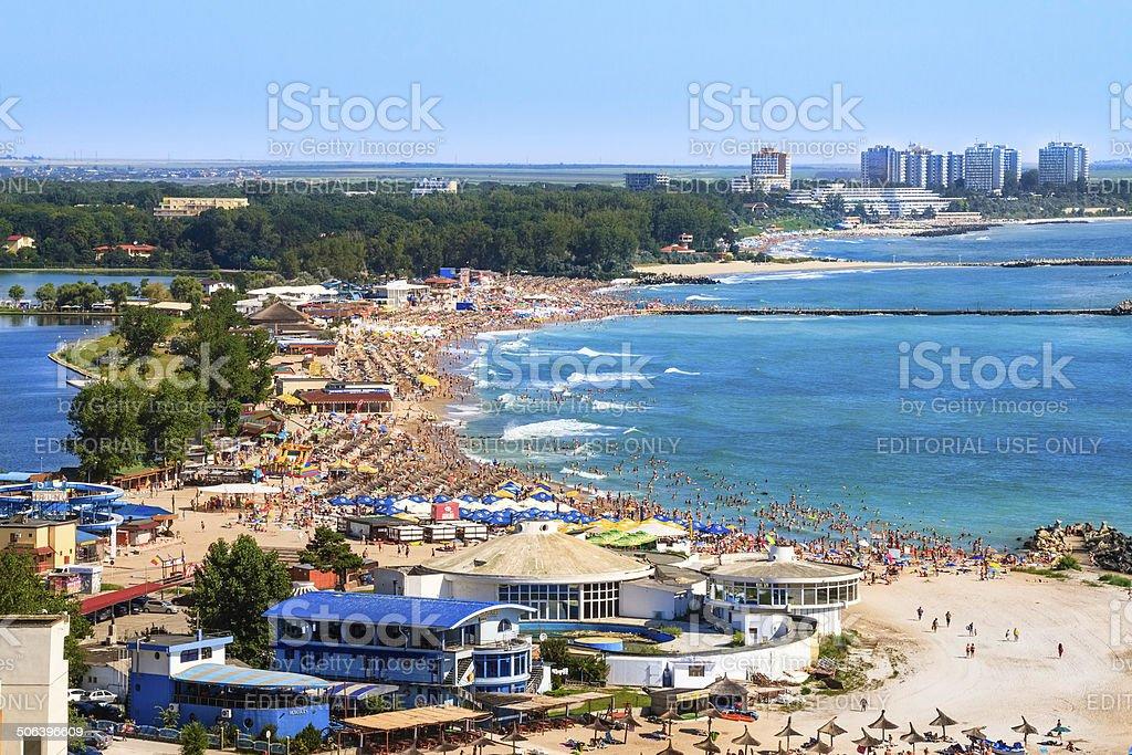 Birdseye panoramic view of a crowded beach stock photo