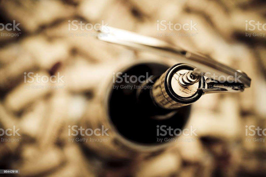 Birdseye view of corkscrew in cork of wine bottle stock photo